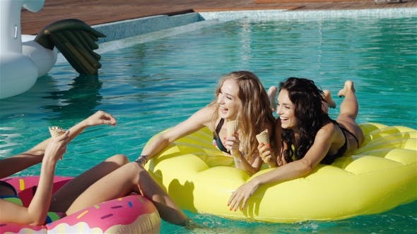 Thumbnail for Friends Eating Ice Cream In a Swimming Pool