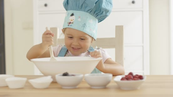 Thumbnail for Adorable Smiling Toddler At Mixing Bowl