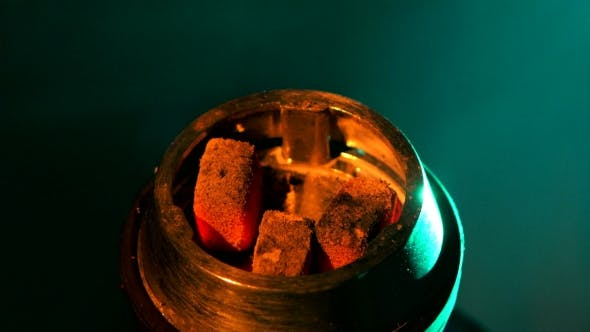 Coals On The Bowl Of Shisha In The Lounge Cafe,