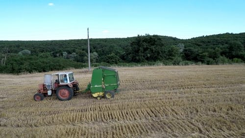 Tractor with Baling Press 13