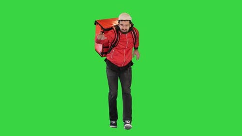 Courier is Delivering Food in Difficult Weather Conditions on a Green Screen Chroma Key