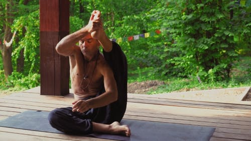 The Man At The Site In The Park Yoga, Performing Asanas.