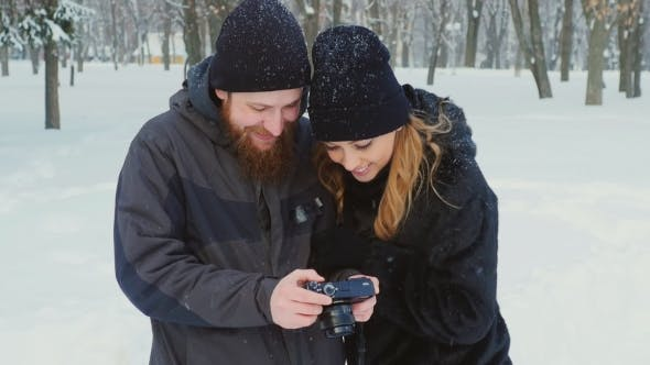 Thumbnail for Young Man And Woman Browsing Photos: Who Had Just Shot In Winter Park