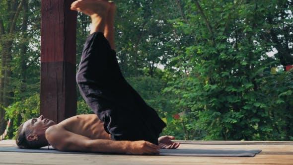 Thumbnail for Yogi Raises Legs And Lowers His Head.