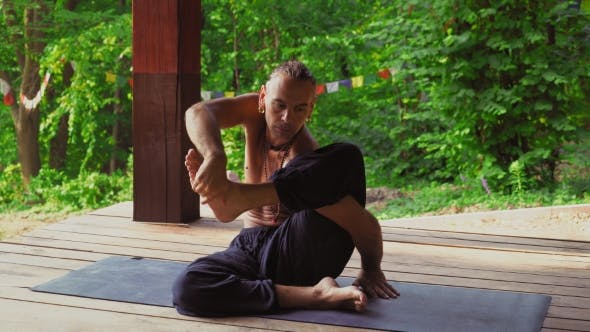Thumbnail for The Man In The Park Demonstrates Exercises With Yoga.