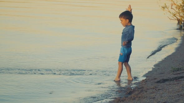 Thumbnail for A Boy Playing Near the Water