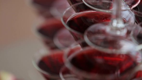 Thumbnail for Triangular Wineglasses, Filled With Red Wine, Stand On Table One By One.