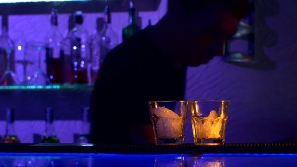 Thumbnail for Bartender Is Making Cocktail At Bar Counter In Dark, Shots