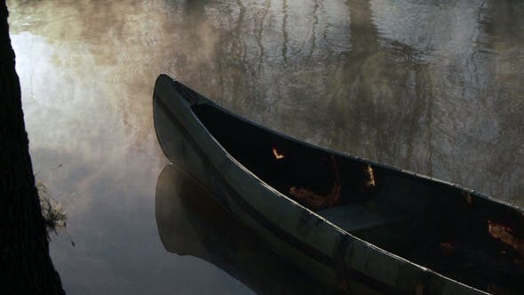 Cover Image for Wooden Canoe Moored in the Misty Lake.