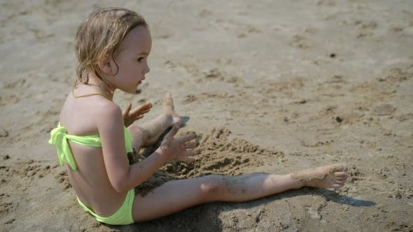 Thumbnail for Adorable Little Girl Playing On White Sand Beach
