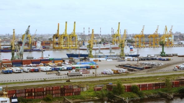 Thumbnail for timelapse of a seaport with cranes, ships, containers and cargo in Saint-Petersburg, Russia