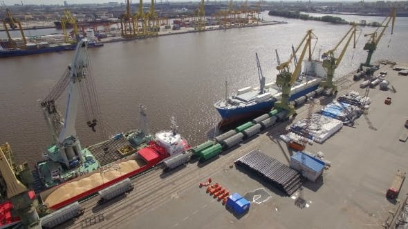 Thumbnail for Aerial view of cargo ship in the port awaiting loading
