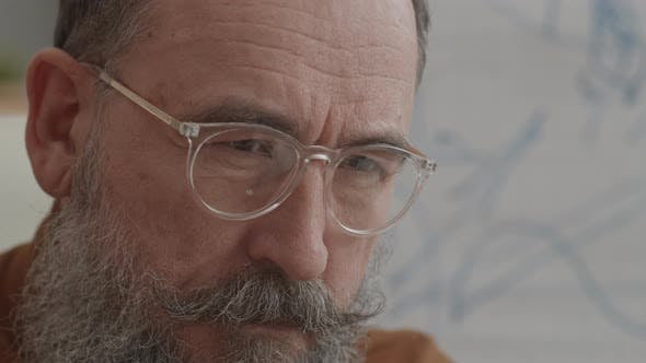 Thumbnail for Concerned Senior Man with Glasses