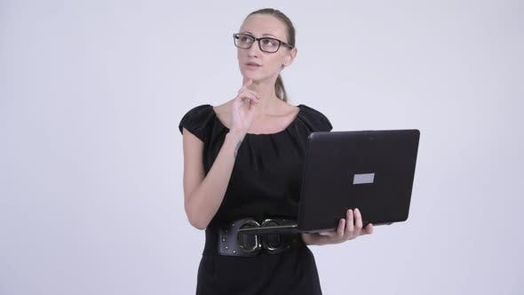 Cover Image for Happy Blonde Businesswoman Thinking While Using Laptop