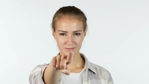 Thumbnail for Young girl pointing finger to the camera in front of white background