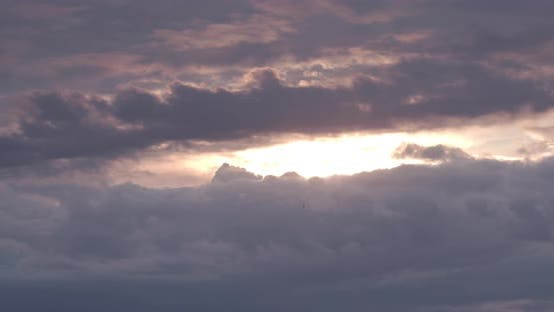The Sun Hides Behind Thick Clouds