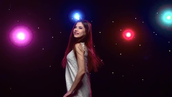 Cover Image for Girl with Long Hair Whirling Against Disco Lights. Slow Motion