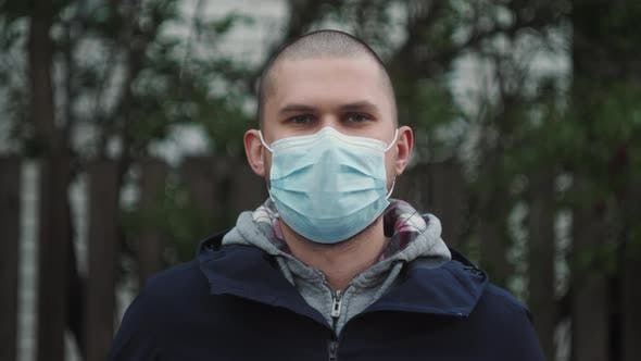 Closeup Portrait of a Bald White Man in a Protective Mask