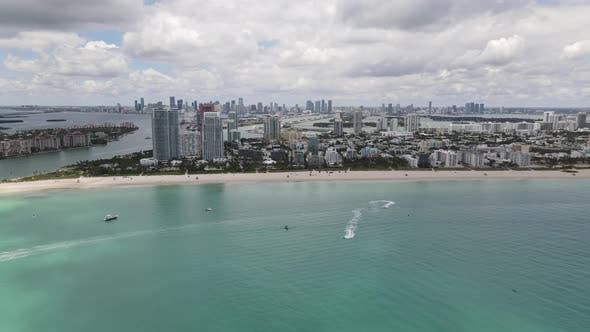 Thumbnail for Aerial wide angle video of Miami Beach with overcast sky clouds
