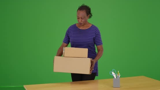 Thumbnail for A black woman receiving package delivery and brining it inside on green screen