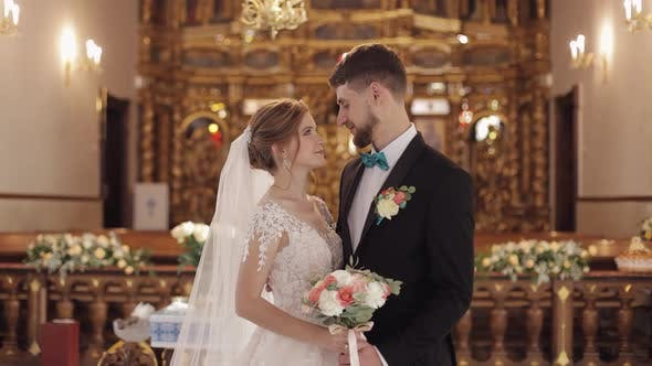Cover Image for Newlyweds. Caucasian Bride and Groom Together in an Old Church. Wedding