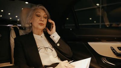 Business Woman Talking Cellphone with office CEO