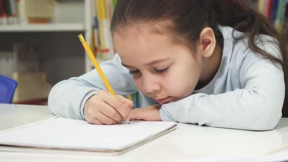 Thumbnail for Adorable Little Girl Drawing in Her Notebook