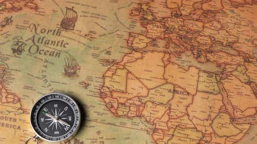 Compass Lying on the Ancient Map