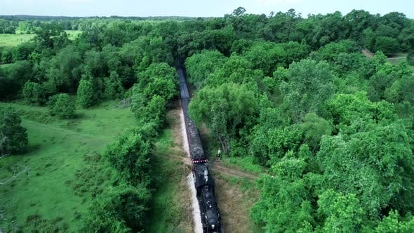 Thumbnail for Aerial View of Old Type Steam Train Black Locomotive Running on the Tracks in the Countryside