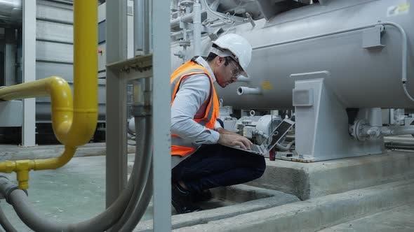 Industrial engineer using laptop inspect