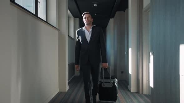 Thumbnail for Business Man Walking at Hotel Corridor. Businessman Arriving at Business Hotel