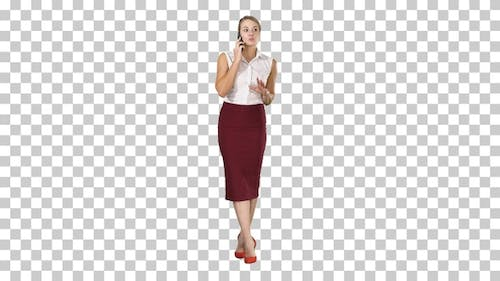 Young happy woman standing and talking on the phone, Alpha Channel