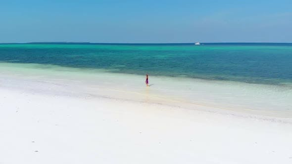 Thumbnail for Aerial slow motion: woman walking on tropical beach, scenic turquoise sea