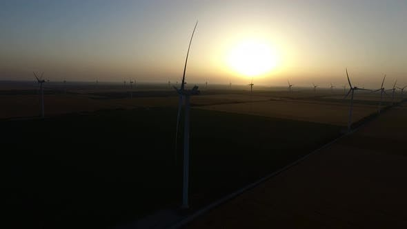 Thumbnail for Wind Turbines in Wheat Fields in Summer at Sunset. Silhouette. Aerial Survey