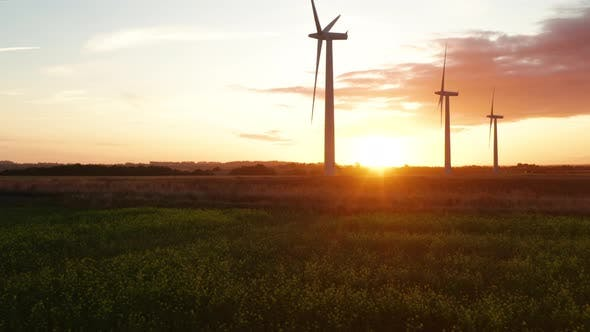 Thumbnail for There wind turbines at sunrise