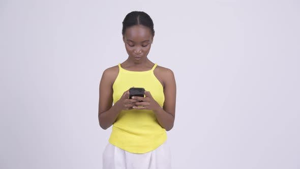 Thumbnail for Happy Young Beautiful African Woman Using Phone
