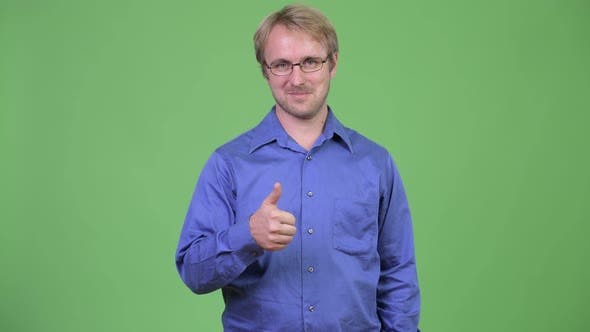 Cover Image for Happy Handsome Blonde Businessman Giving Thumbs Up