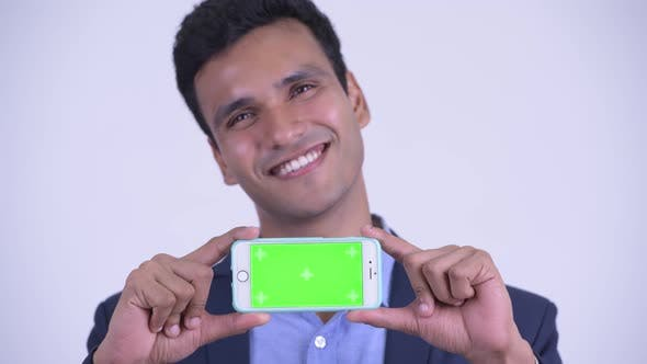 Thumbnail for Face of Happy Young Indian Businessman Showing Phone