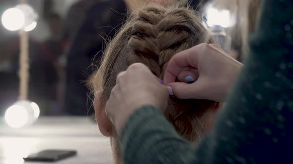 Thumbnail for Hairdresser Makes Pigtails To a Girl