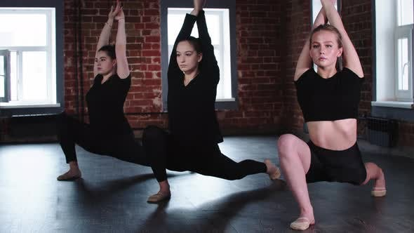 Thumbnail for Fitness  Three Young Flexible Women Doing Stretching
