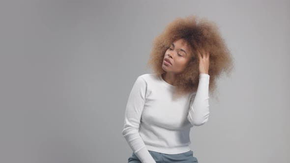 Mixed Race Black Woman with Big Afro Hair in Studio Alone