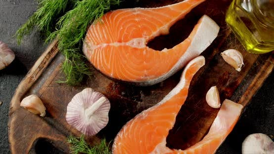 Raw Salmon Steaks with Garlic and Dill Slowly Rotate.