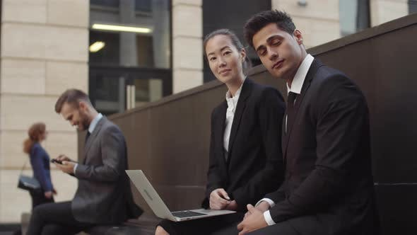 Thumbnail for Diverse Businessman and Businesswoman Working Outdoors