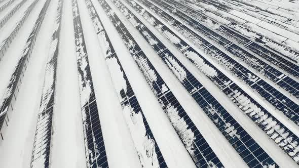 Thumbnail for AERIAL: Solar Panel Field with Snow on Panels. Alternative Energy Sources in the Nordic Countries.