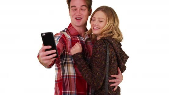 Millennial couple or friends taking selfies together in studio with copyspace