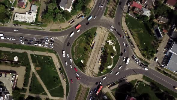 Thumbnail for Drone Flying Above Busy Roundabout in Rush Hour