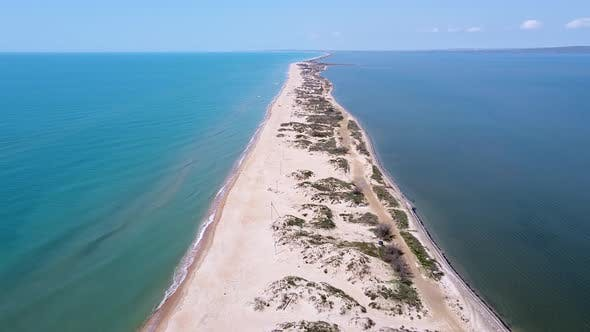A long sandy spit with a beautiful azure sea