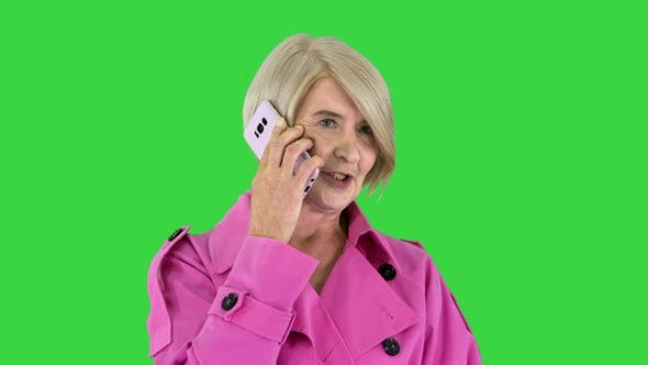 Thumbnail for Grandmother Calling Loving Fashionable Modern Grandmother Wearing Pink Trench Coat Making a Call on