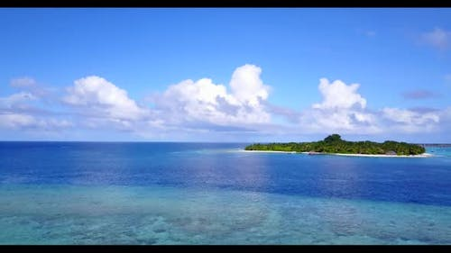 Aerial seascape of tranquil seashore beach adventure by transparent sea and clean sand background of