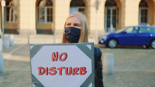 No Disturb Slogan on Protest Walk